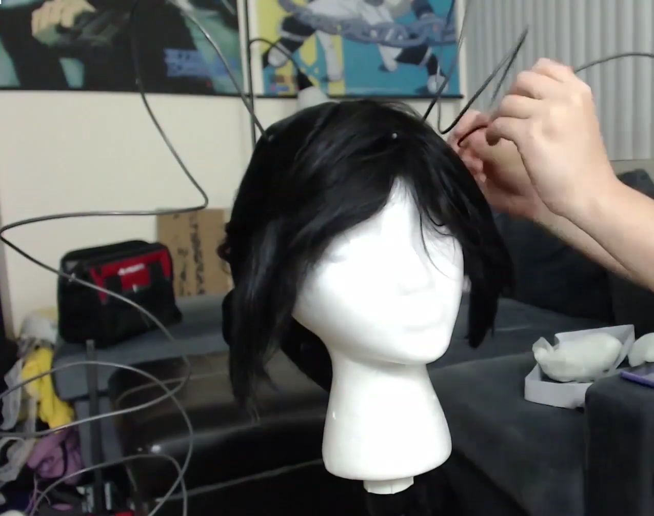 picture of base wig with wires coming out in curled shapes